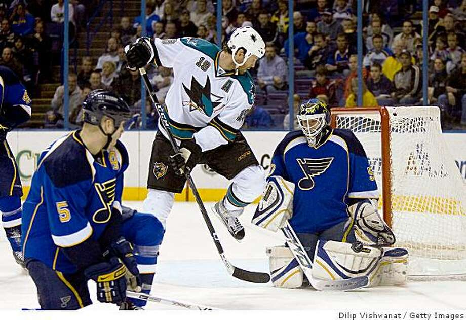 ST. LOUIS, MO. - MARCH 12: Chris Mason #50 of the St. Louis Blues makes a save against Joe Thornton #19 of the San Jose Sharks at the Scottrade Center on March 12, 2009 in St. Louis, Missouri.  (Dilip Vishwanat/Getty Images) Photo: Dilip Vishwanat, Getty Images
