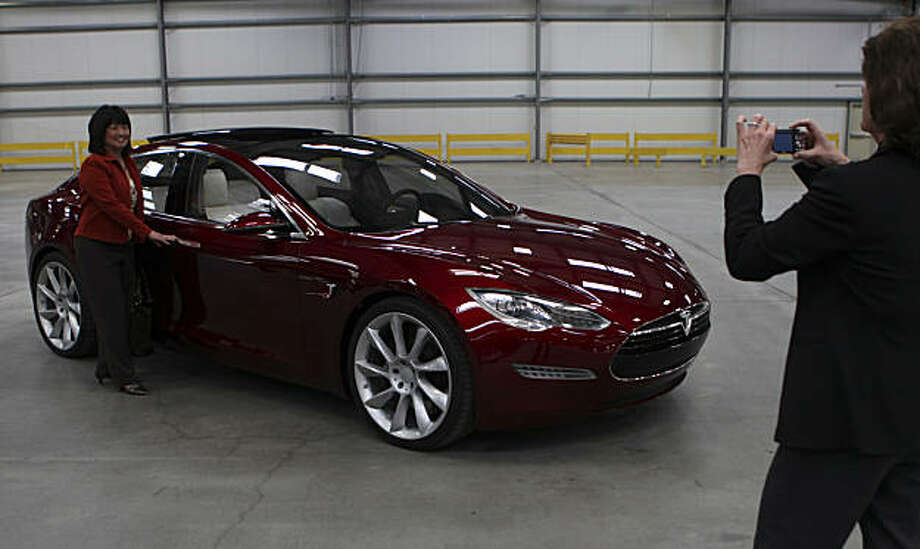 Fremont Assistant City Attorney Joan Borger takes a picture of her colleague Fremont City Council Member Sue Chan next to the new Tesla Model S during a tour of the facility on Wednesday, October 27, 2010 in Fremont, Calif.  Photo: John Sebastian Russo, The Chronicle