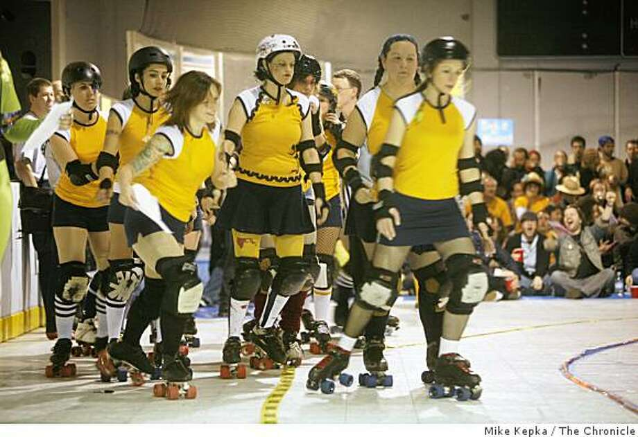 """""""San Francisco Shevil Dead"""" line up and go head-to-head with another team from the Bay Area Derby Girls roller derby league at the Dry Ice Rink in Oakland, CA. Photo: Mike Kepka, The Chronicle"""