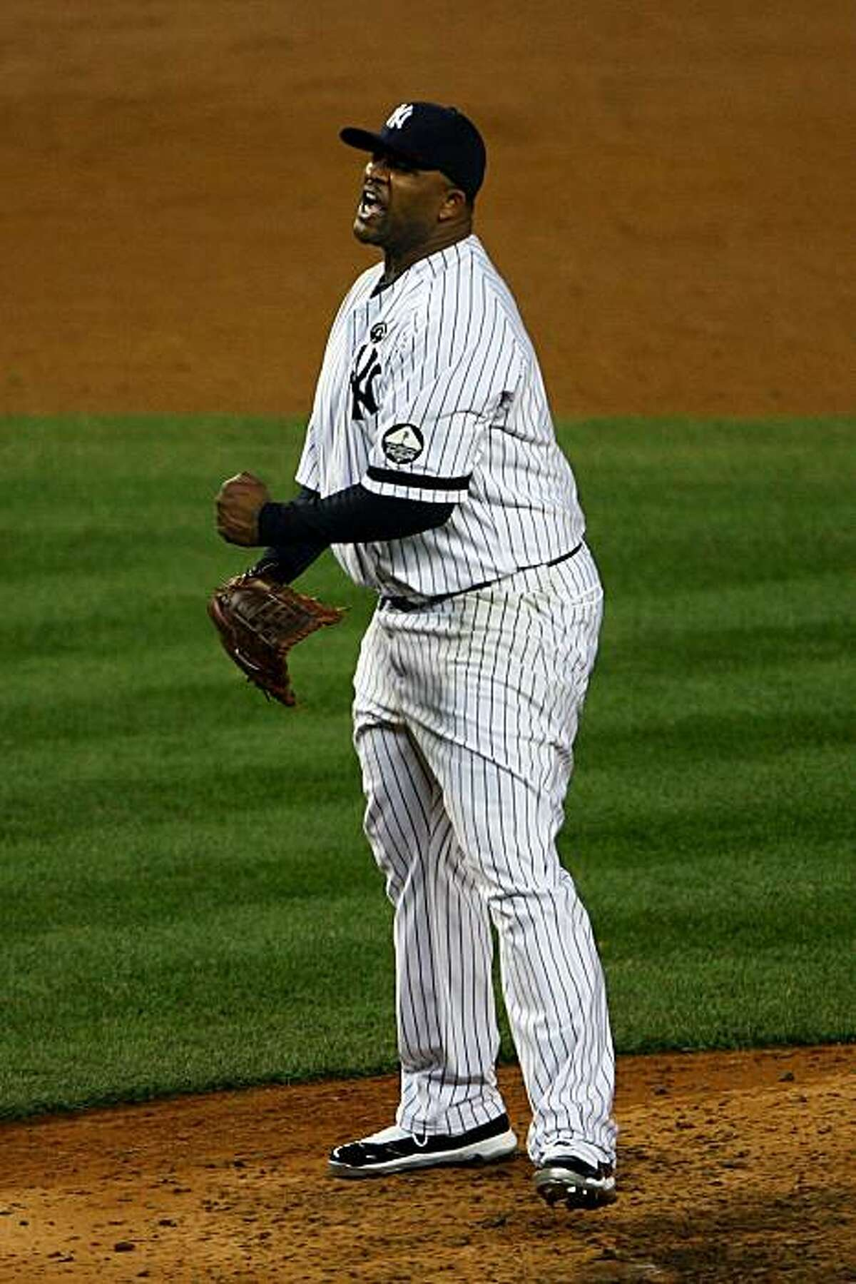 NEW YORK - OCTOBER 20: CC Sabathia #52 of the New York Yankees reacts after he struck out Mitch Moreland #18 of the Texas Rangers to end the top of the sixth inning of Game Five of the ALCS during the 2010 MLB Playoffs at Yankee Stadium on October 20, 2010 in the Bronx borough of New York City.