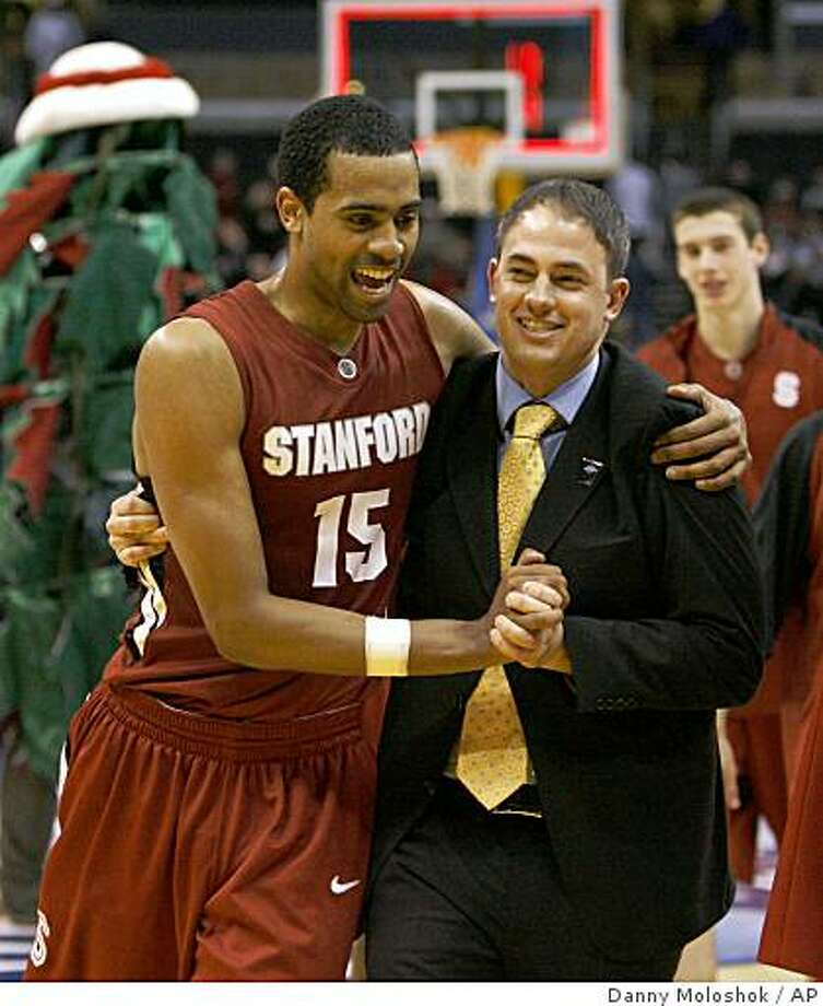 Stanford's Lawrence Hill, left, and assistant coach Mike Schrage celebrate together after Stanford defeated Oregon State in an NCAA college basketball game at the Pac-10 men's tournament in Los Angeles on Wednesday, March 11, 2009. Stanford won 62-54. (AP Photo/Danny Moloshok) Photo: Danny Moloshok, AP