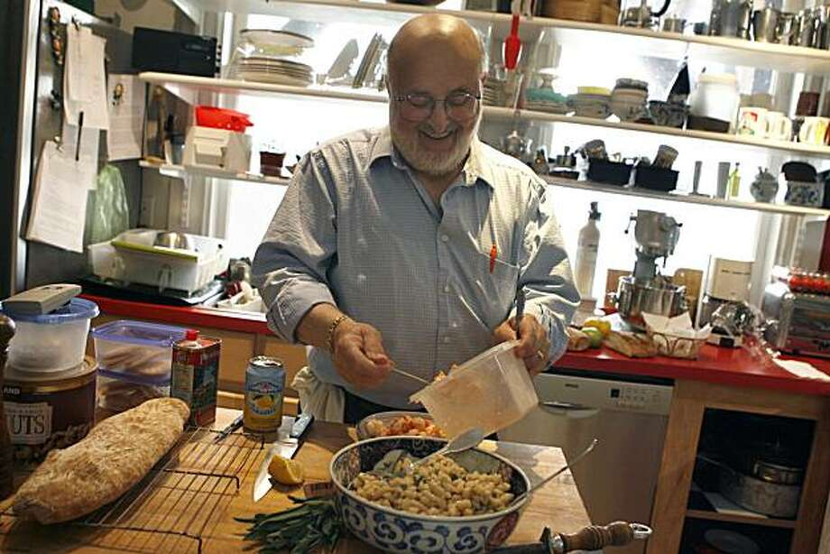Carlo Middione prepares a dish of shrimp and garlic in his home kitchen in San Francisco, Calif. on Monday, Oct.4, 2010. Middione influenced the cuisine dining scene in San Francisco, Calif. throughout the 1980s and 1990s while heading the Vivande Porte Via restaurant as its chef owner before it closed at the end of 2009 following a 2008 car accident that affected his sense of smell. Photo: Kirsten Aguilar, The Chronicle