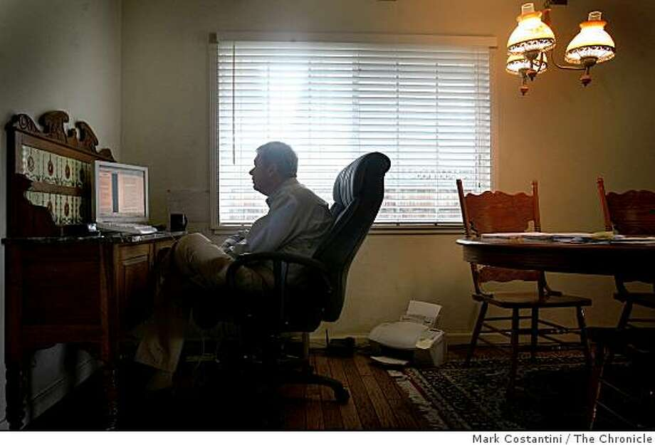 Doug Horan, 62, worked for decades in the semiconductor industry, before getting advanced training in medical device marketing sits in his kitchen in Los Gatos, Calif. on Wednesday, March 4, 2009   looking for work. He was laid off from his last job a year and a half ago and now spends about 8 hours a day working out of his kitchen searching for a job. Photo: Mark Costantini, The Chronicle