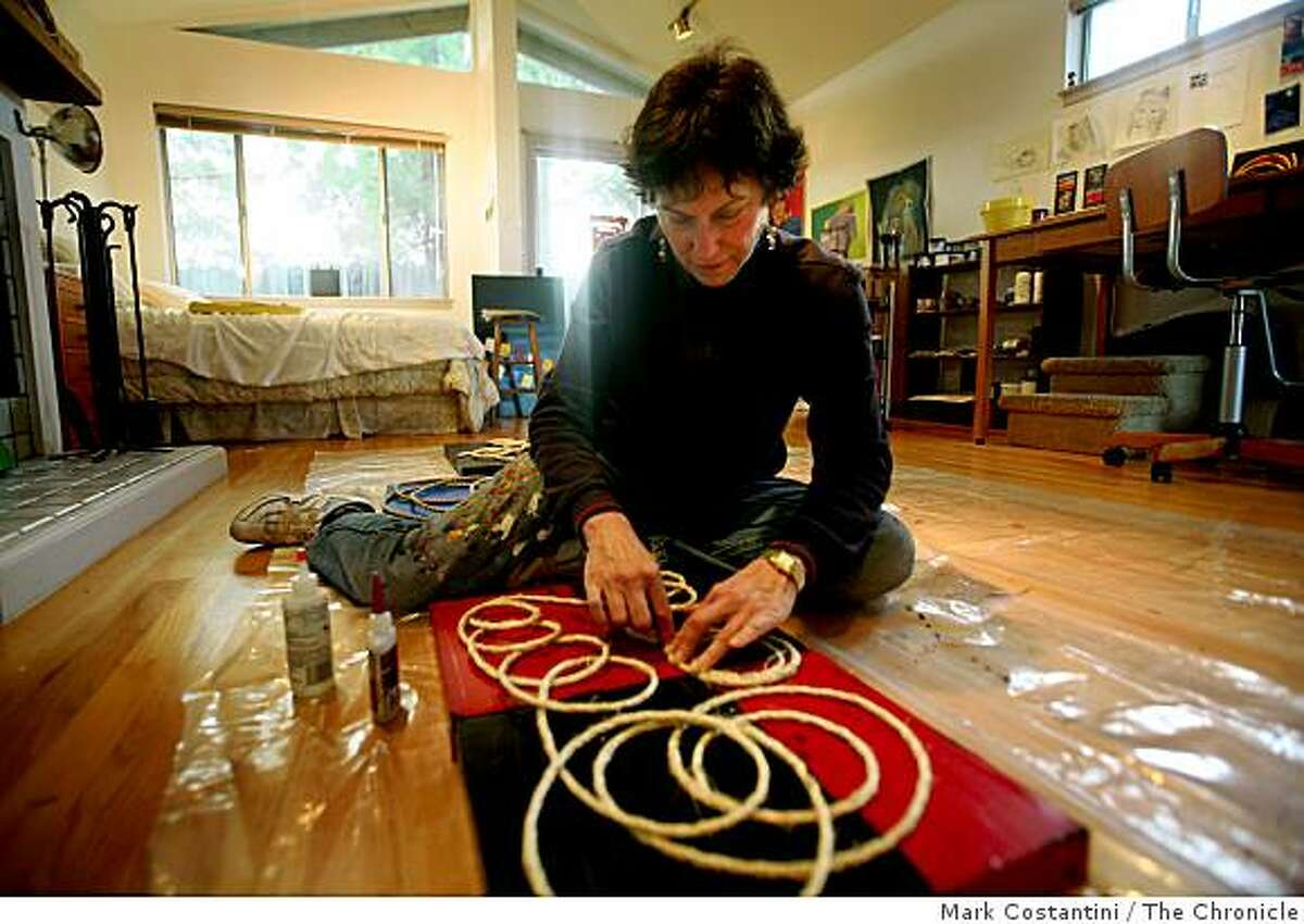 Margery Entwisle, 62, a CPA who has worked as the controller for the San Francisco Opera and for Bank of America has spent much of the last year looking for part time work as a bookkeeper. Entwisle gave up the job hunt and has turned to something she loves, her art. She is photographed working on her art in her cottage/art studio in Mill Valley, Calif. on Thursday, March 5, 2009.