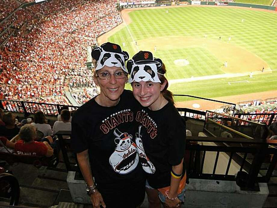 Giants fan Sarah Langs (right; her hometown is N.Y., N.Y.) with her mother Liise-anne Pirofski (spelling is cq) at a 2010 Giants-Cardinals game in St. Louis. Photo: Courtesy Sarah Langs