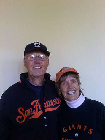Peggy Prescott (right, of Napa) and Tom Prescott in October, 2010. Giants fans. Tom is wearing a Seals cap. Prescott's father Dud Smith played for the Seals. Photo: Courtesy Peggy Prescott