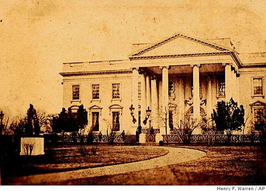 This March 6, 1865 photo by Henry F. Warren provided by the Collection Keya Morgan/LincolnImages.com, show the White House with several figures standing in front of it. Photography collector Keya Morgan says the photo is the only known photograph of Lincoln standing in front of the White House, and the first photo ever to have been taken of a President in front of the White House. (AP Photo/Collection of Keya Morgan, LincolnImages.com) **NO SALES** Photo: Henry F. Warren, AP