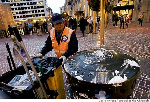 Martin Condol cleans up after a flash mob pie fight at the Powell and Market cable car turn around share a dance in the aftermath of the fight in San Francisco, Calif., on Thursday, March 5, 2008. Photo: Laura Morton, Special To The Chronicle