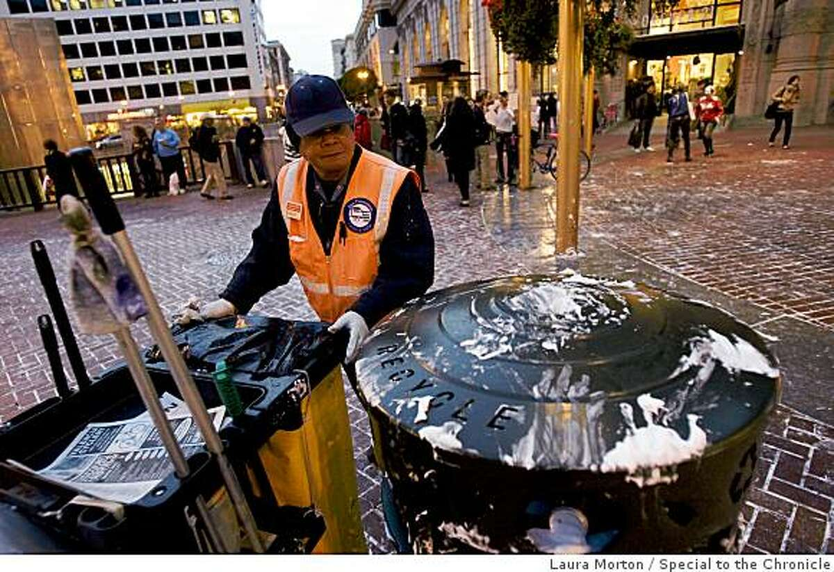 Martin Condol cleans up after a flash mob pie fight at the Powell and Market cable car turn around share a dance in the aftermath of the fight in San Francisco, Calif., on Thursday, March 5, 2008.
