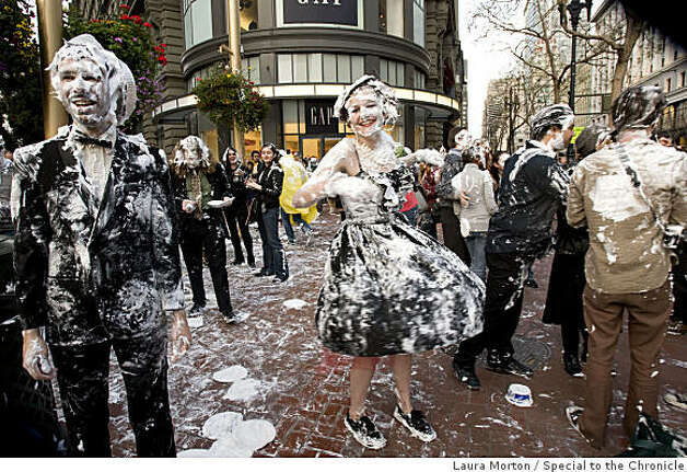 Patty Larnecy dances in the aftermath of a flash mob pie fight at the Powell and Market cable car turn around share a dance in the aftermath of the fight in San Francisco, Calif., on Thursday, March 5, 2008. Photo: Laura Morton, Special To The Chronicle