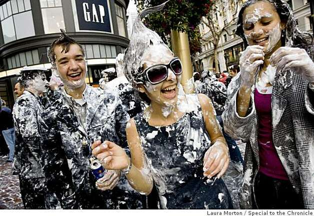 Logan Hollarsmith, Julia Tejeda and Mia Didacha (left to right) share a laugh in the aftermath of the flash mob pie fight at the Powell and Market cable car turn around in San Francisco, Calif., on Thursday, March 5, 2008. Photo: Laura Morton, Special To The Chronicle