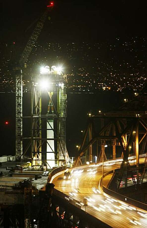 A section of the new Bay Bridge tower is hoisted into place. Photo: Adm Golub, The Chronicle