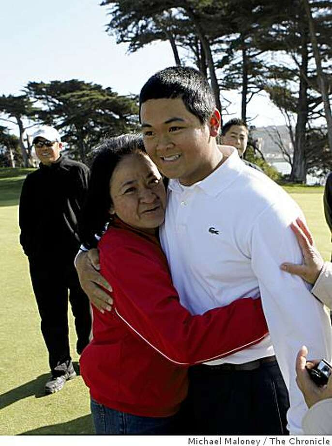 Esther Briones hugs her son 14 year old Carlos Briones after he won the final round of the San Francisco City Golf Championship at Harding Park on Sunday, March 8, 2009. Photo: Michael Maloney, The Chronicle