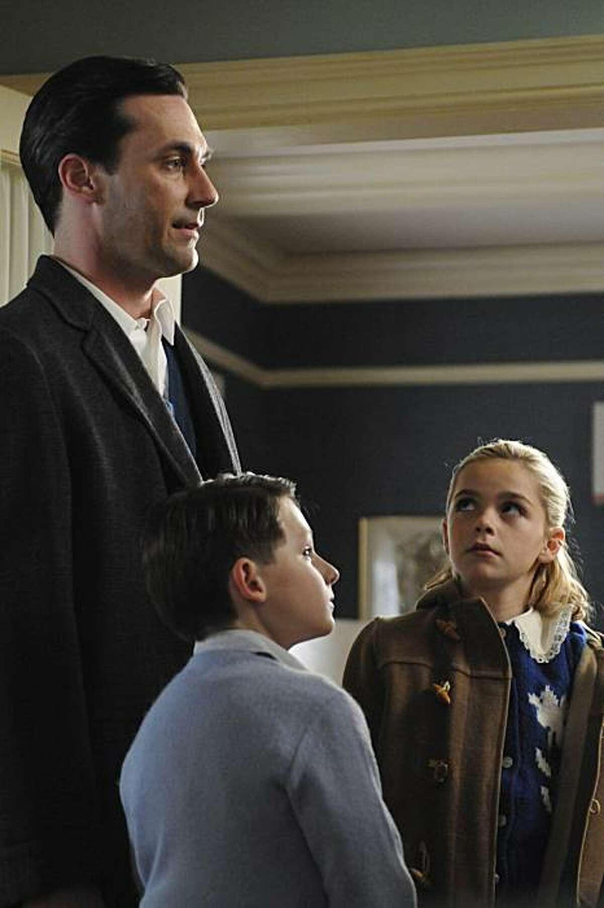Don Draper (Jon Hamm), Sally Draper (Kiernan Shipka) and Bobby Draper (Jared S. Gilmore) appear in Season 4 of