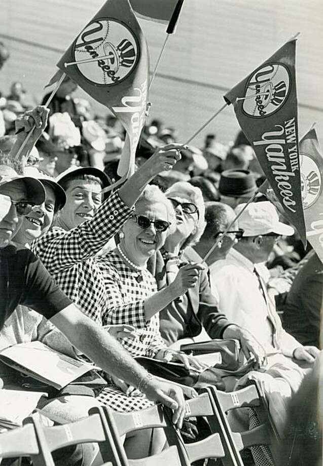 October 4, 1962 - Yankee fans from Newark, NJ, Eleanor Koehler, Marie Koehler and Ann Kertis wave their Yankee pendants at the World Series in San Francisco. Photo: Peter Breinig, The Chronicle, 1962