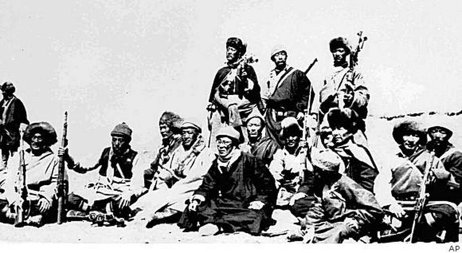 ** FILE ** In this March 1959 file photo, Tibetan leader the Dalai Lama, sixth from left, rests with members of an escape party who protected him during his flight to exile across the Himalayas. The Dalai Lama fled the Tibetan capital Lhasa on the night of March 17, 1959 after a failed Tibetan uprising against Chinese rule. Tibetans are about to mark the 50th anniversary of the failed March 10, 1959 uprising. (AP Photo/File) Photo: AP