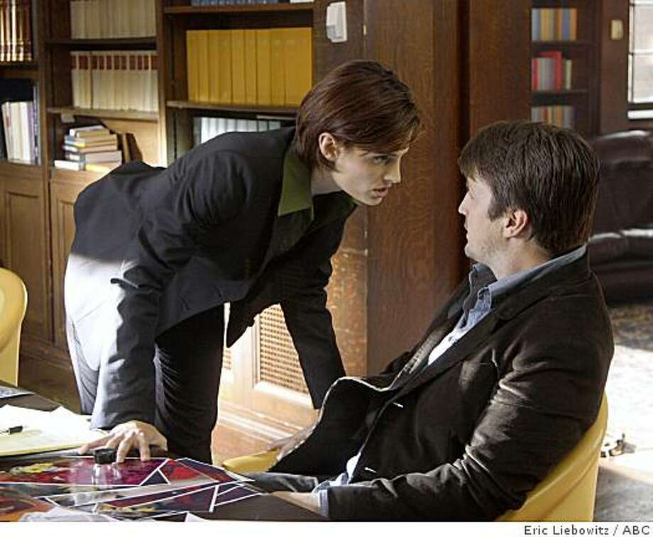 "CASTLE -- ""Flowers for Your Grave"" -- In the premiere episode of ABC's new midseason series, ""Castle,"" a wildly famous mystery novelist, Richard Castle (Nathan Fillion, ""Desperate Housewives""), who is bored with his own success, learns that a real-world copycat killer has started staging murders from scenes depicted in his novels. Castle is questioned by NYPD Detective Kate Beckett (Stana Katic, ""The Spirit""), a bright and aggressive detective who keeps her investigations under a tight rein. Though they instantly clash, sparks of another sort also begin to fly, leading both to danger and a hint of romance as Castle steps in to help find the killer. Photo: Eric Liebowitz, ABC"