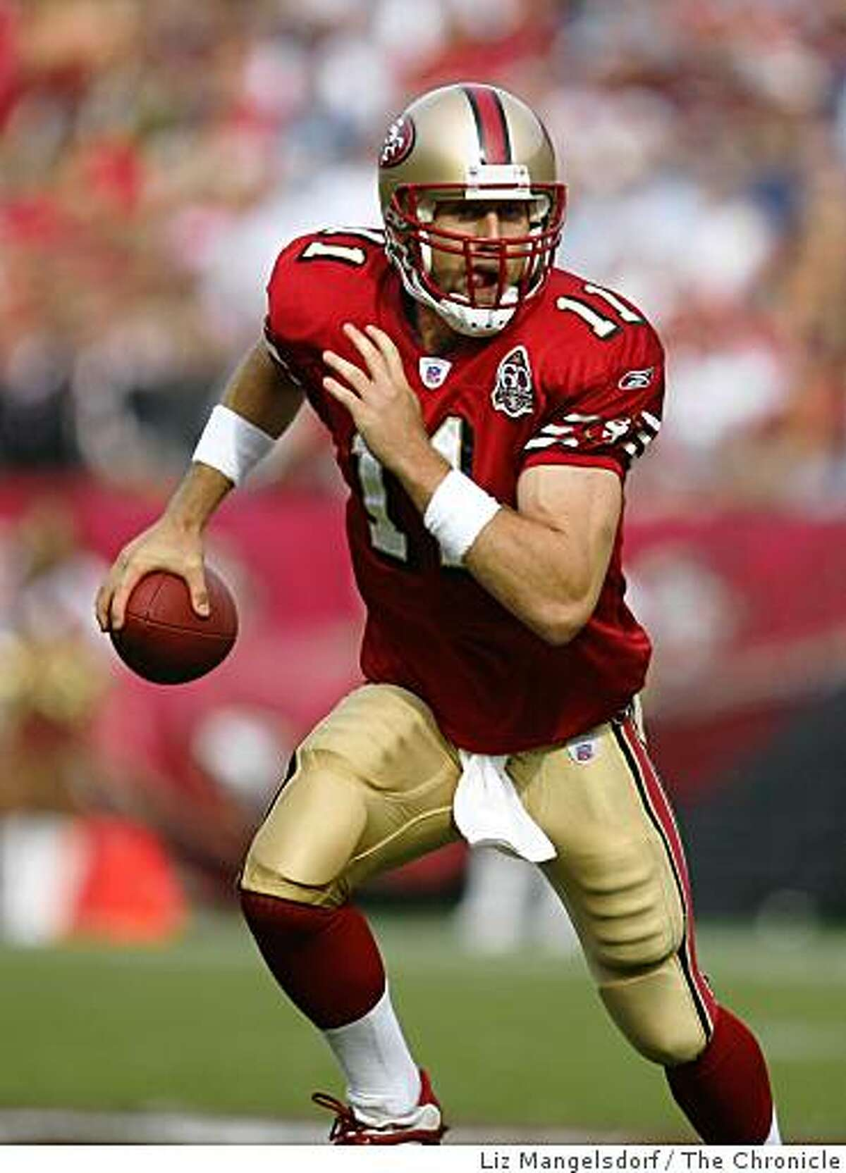 San Francisco 49ers quarterback Alex Smith (11) rolls out in the first quarter.