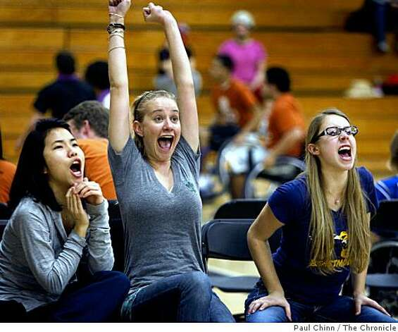 Melody Mo, Callan Coles and Amanda Bozigian (L to R) cheer for teammates who scored during the Roll 'n Shoot wheelchair basketball tournament in Berkeley, Calif., on Saturday, March 7, 2009. Photo: Paul Chinn, The Chronicle