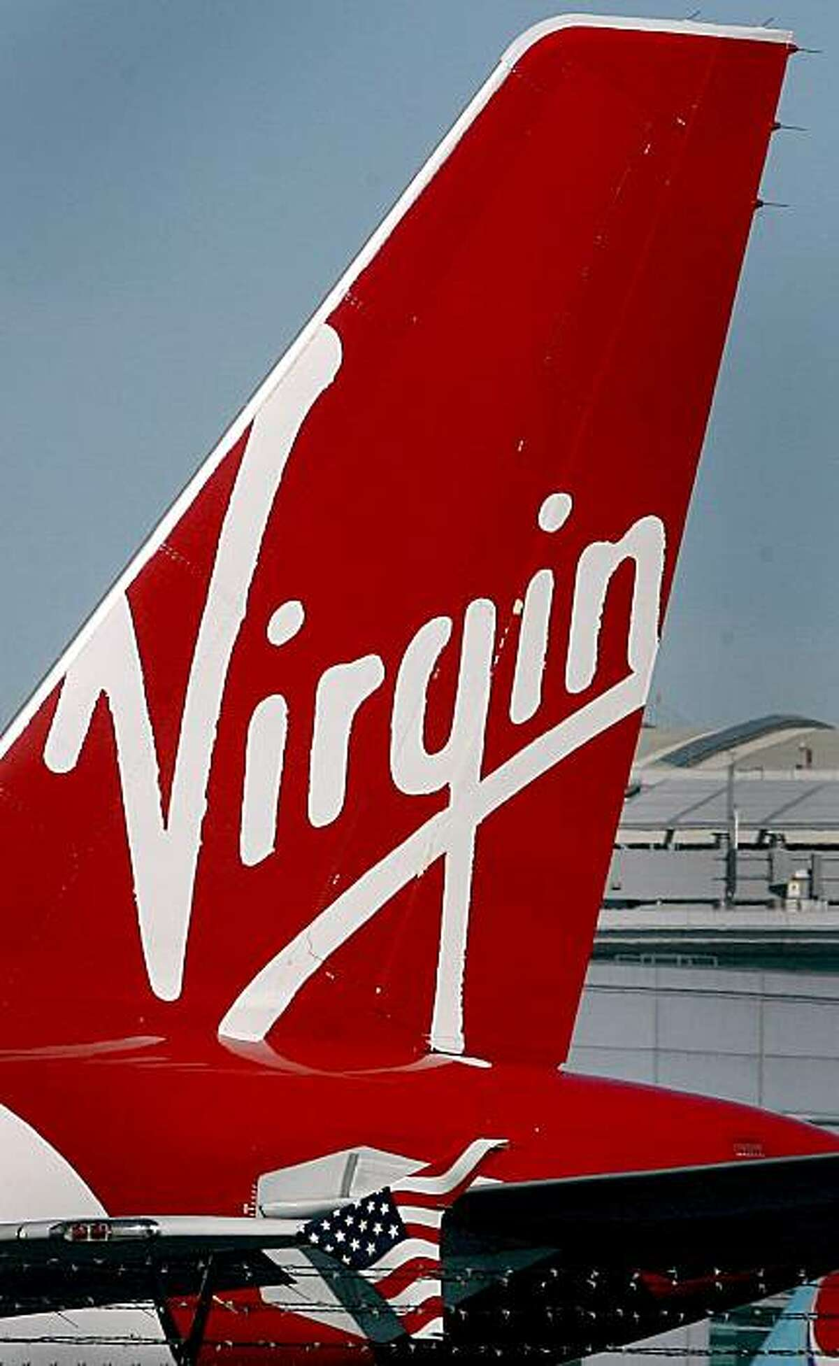 A Virgin America logo on one of its planes is photograrped at San Francisco International Airport near Millbrae, Calif. on Tuesday March 10, 2009.