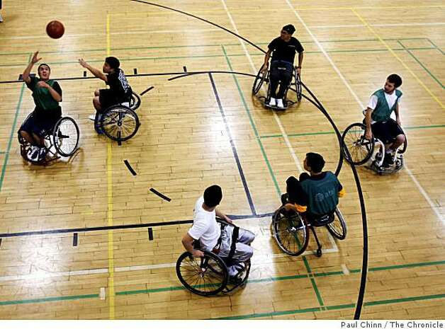 Two teams square off in the three-on-three Roll 'n Shoot wheelchair basketball tournament in Berkeley, Calif., on Saturday, March 7, 2009. Photo: Paul Chinn, The Chronicle