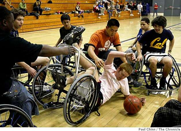 A participant hits the deck during a game at the Roll 'n Shoot wheelchair basketball tournament in Berkeley, Calif., on Saturday, March 7, 2009. Photo: Paul Chinn, The Chronicle