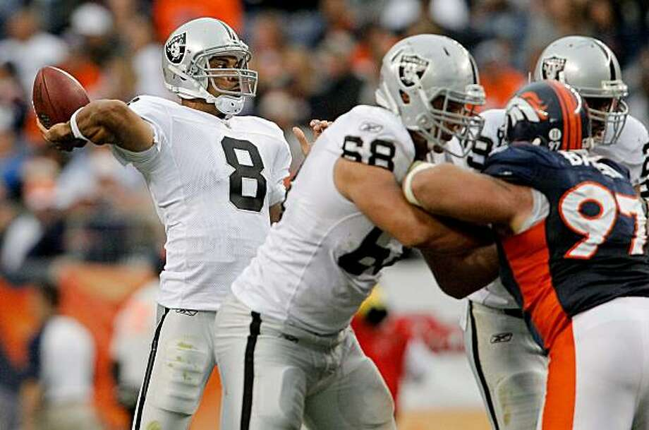 DENVER - OCTOBER 24:  Quarterback Jason Campbell #8 of the Oakland Raiders makes a pass against the Denver Broncos in the third quarter at INVESCO Field at Mile High on October 24, 2010 in Denver, Colorado. The Raiders defeated the Broncos 59-14. Photo: Justin Edmonds, Getty Images