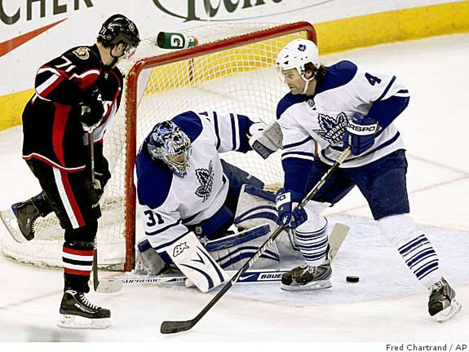Ottawa Senators' Nick Foligno, 71, and Toronto Maple Leafs goaltender Curts Joseph look for the puck as Jeff Finger, right,  defends during the first period of an NHL hockey game  in Ottawa on Monday,  March 9, 2009. (AP Photo/The Canadian Press,Fred Chartrand) Photo: Fred Chartrand, AP