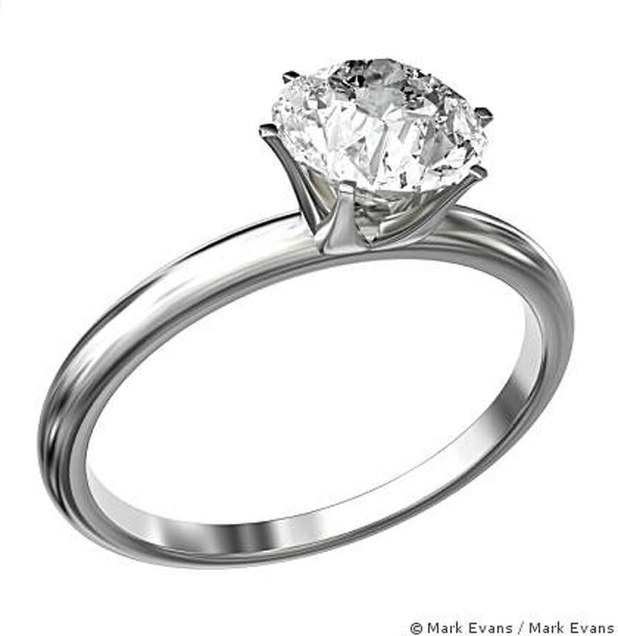 White gold ring with a large princess cut diamond isolated on a white background. Very high resolution 3D render. Photo: � Mark Evans, Mark Evans