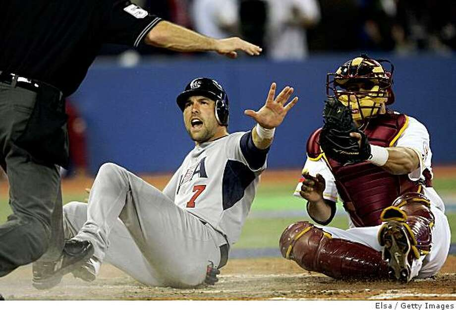TORONTO, ON - MARCH 08:  Mark DeRosa #7 of the USA is safe at home as Ramon Hernandez #19 of Venezuela looks on during the 2009 World Baseball Classic Pool C match on March 8, 2009 at the Rogers Centre in Toronto, Ontario, Canada.  (Photo by Elsa/Getty Images) Photo: Elsa, Getty Images