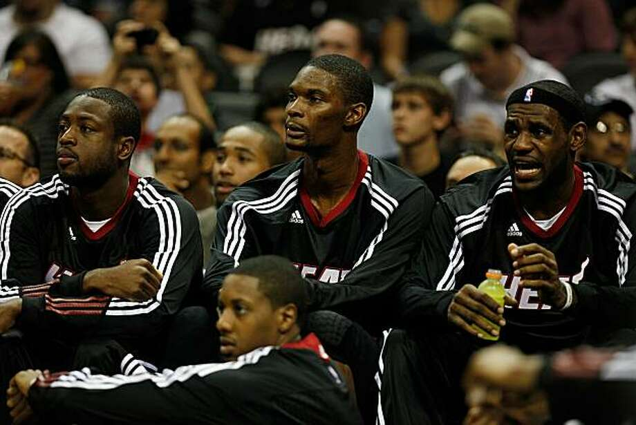 SAN ANTONIO - OCTOBER 09:  Dwayne Wade #3, Chris Bosh #1 and LeBron James #6 of the Miami Heat sit on the bench during the game against the San Antonio Spurs at the AT&T Center on October 9, 2010 in San Antonio, Texas.  NOTE TO USER: User expressly acknowledges and agrees that, by downloading and/or using this Photograph, User is consenting to the terms and conditions of the Getty Images License Agreement. Photo: Chris Graythen, Getty Images