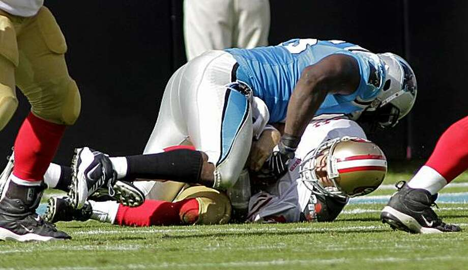 San Francisco 49ers' Alex Smith, bottom, is sacked by Carolina Panthers' Charles Johnson, top, during the second half of an NFL football game in Charlotte, N.C., Sunday, Oct. 24, 2010. Smith was injured on the play. Photo: Rick Havner, AP