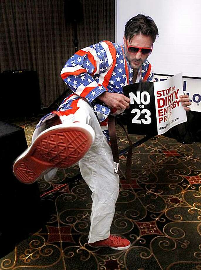 "Actor David Arquette executes a martial arts kick to promote a series of online videos opposing Proposition 23, following a news conference in Sacramento, Calif., Tuesday, Oct. 19, 2010.   In a video titled ""Don't Mess With California,"" Arquette portraysCalifornia and proceeds to knock out a group of thugs representing Texas oil interests.  Oil companies have donated the bulk of the money to support Prop. 23, which if approved by voters in the November election, would indefinitely suspend AB32, California's landmark environmental law. Photo: Rich Pedroncelli, AP"