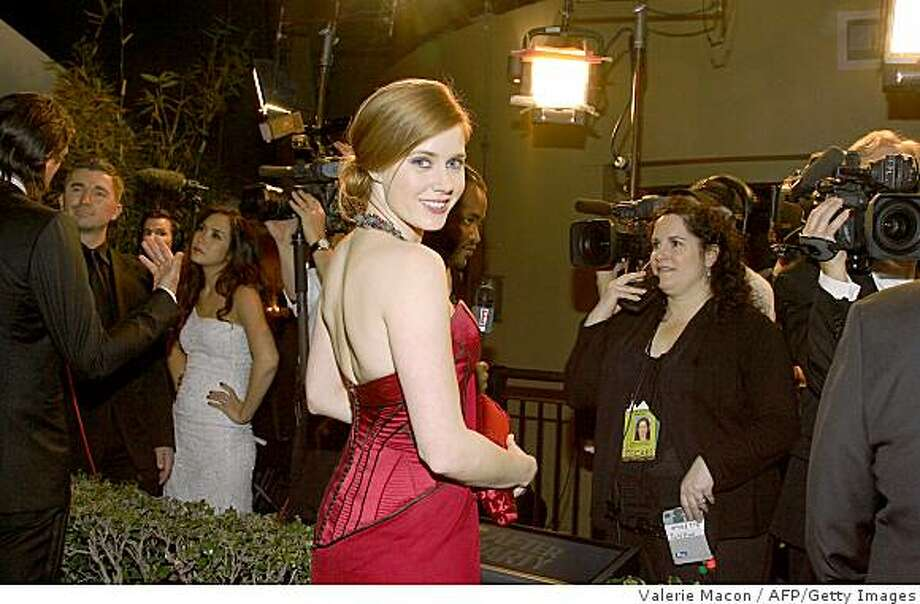 "Actress Amy Adams attends the 2009 Governor's Ball in Hollywood, California, on February 22, 2009 after the Academy Awards show. Rags-to-riches drama ""Slumdog Millionaire"" swept the board at the 81st Academy Awards, winning eight Oscars including best picture on a night of high-voltage Hollywood glamor. Photo: Valerie Macon, AFP/Getty Images"