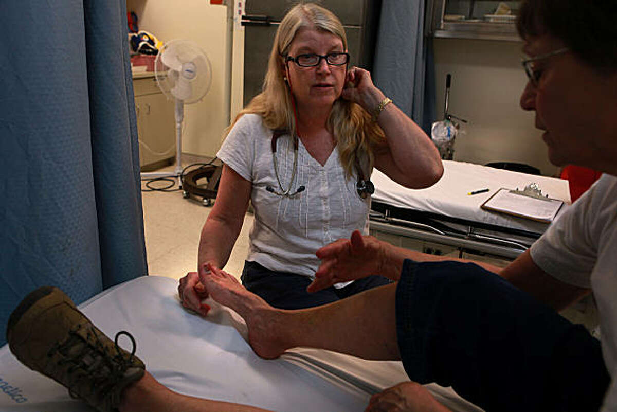 Nurse practitioner Debbie Rubio-Derhammer (middle) tends to Anna deMauriac from Tucsan who has a swollen toe at Yosemite Valley Medical Clinic in Yosemite Valley, Calif., on Monday September 13, 2010. Anna has hiked 30 miles of selected trails so far, starting at Bend, Oregon.