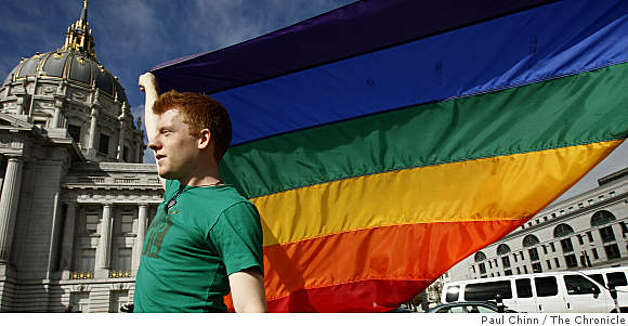 UC Berkeley student Doug Williams waves a rainbow flag while the California State Supreme Court hears arguments over the constitutionality of Proposition 8 in San Francisco. Photo: Paul Chinn, The Chronicle