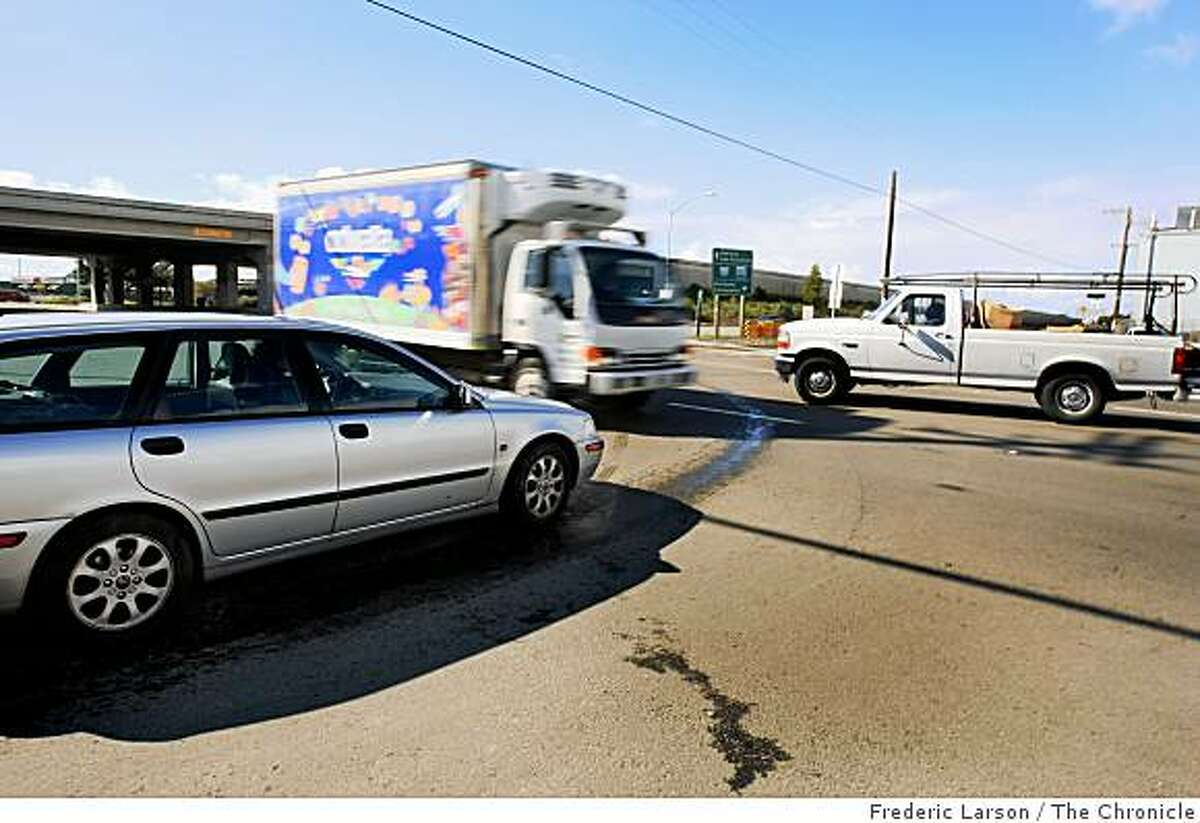 Three cars attempt to navigate through the intersection of Gilman Street and Interstate 80 in Berkeley, where 14 lanes converge with no stoplights. To solve the problem, the city plans to build a $10 million double roundabout.