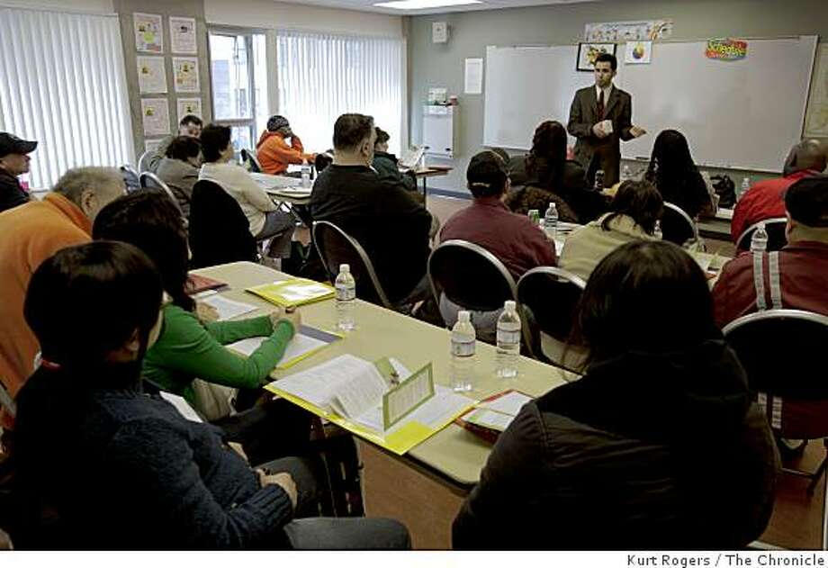 Marco Chavarin the Program Coordinator with Bank on San Francisco talks to people talking a class at The Salvation Army on getting your credit restored. on Thursday  Mar 5,  2009 in San Francisco, Calif Photo: Kurt Rogers, The Chronicle