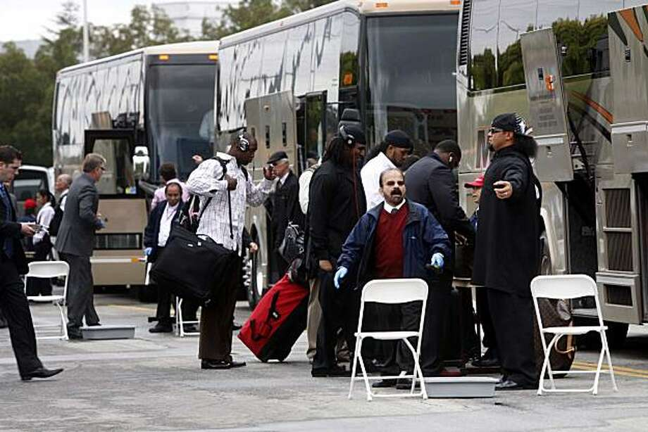 With the 49ers ready for an 11 day road trip, players and coaches board a train of 5 buses headed for the airport on Friday Oct. 22, 2010 in Santa Clara, Calif. Photo: Mike Kepka, The Chronicle