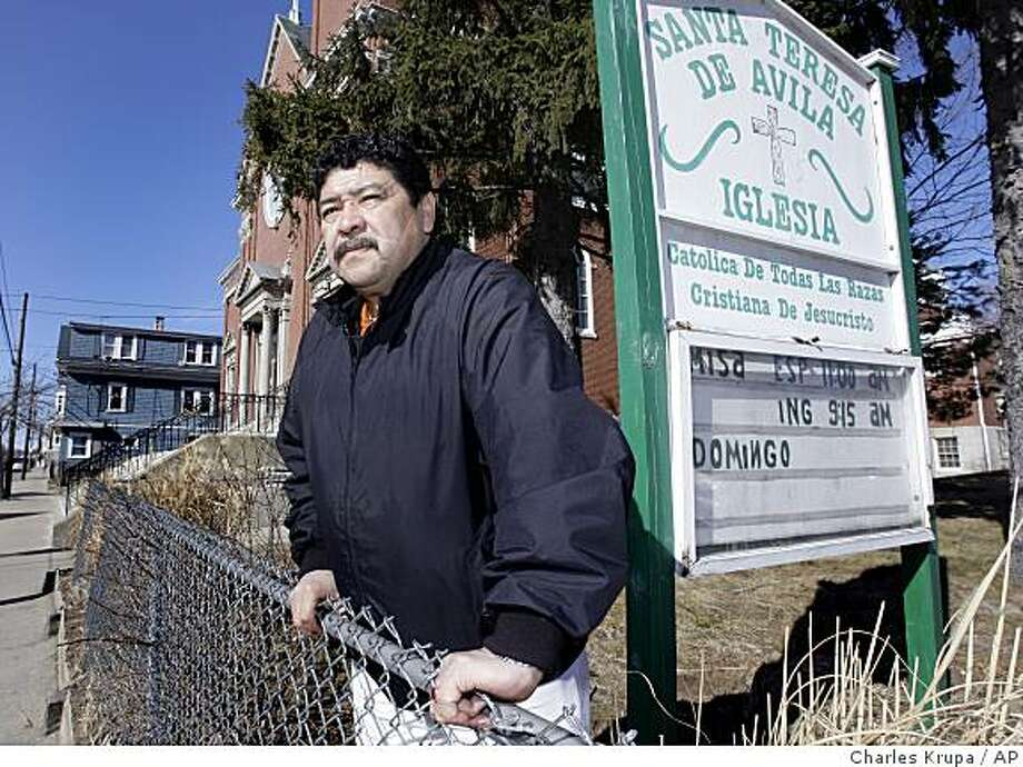 **APN ADVANCE FOR MARCH 8** Immigrant right's advocate Juan Garcia poses outside his church in Providence, RI., Monday Feb. 17, 2009.  Garcia, who came to the United States in 1977, has emerged as the go-to person for immigrants unwilling to work with police or state agencies for fear they or someone they love could be deported. (AP Photo/Charles Krupa) Photo: Charles Krupa, AP