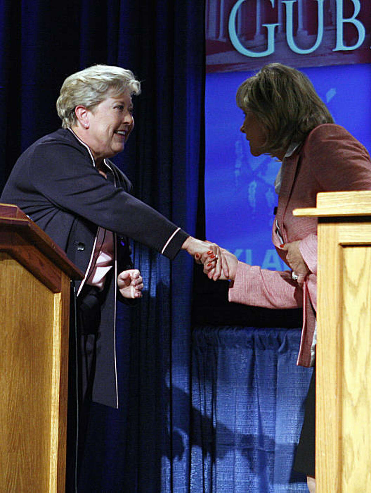Democrat Lt. Gov. Jari Askins, left, and Rep. Mary Fallin, right, R-Okla., shake hands before a gubernatorial debate on the campus of the University of Central Oklahoma in Edmond, Okla., on Tuesday, Oct. 19, 2010.