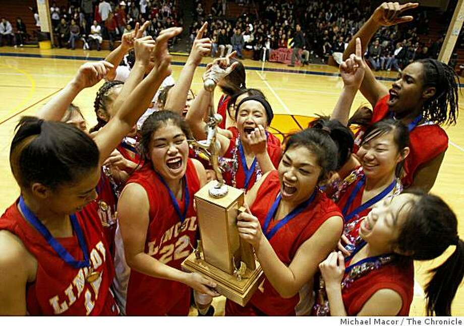 Lincoln girls celebrate their victory over Lowell 48-37 to take the championship in a battle for the title between Lowell and Abraham Lincoln high schools at Kezar Pavilion in San Francisco, Calif. on Friday Mar. 6, 2009. Photo: Michael Macor, The Chronicle