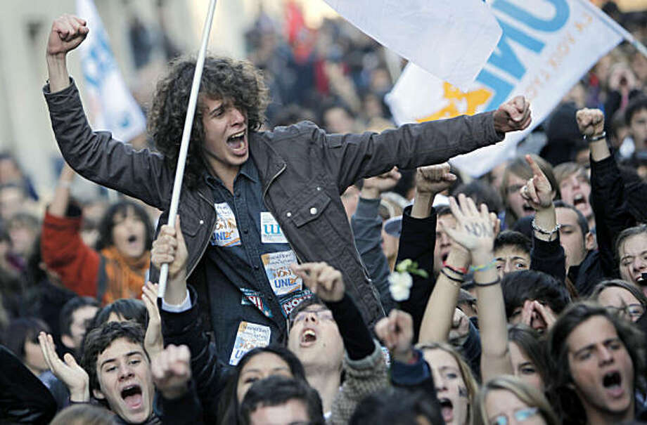 A student encourages others during a demonstration in Paris, Thursday Oct. 21, 2010. Protesters blockaded Marseille's airport, Lady Gaga canceled concerts in Paris and rioting youths attacked police in Lyon on ahead of a tense Senate vote on raising the retirement age to 62. A quarter of the nation's gas stations were out of fuel despite President Nicolas Sarkozy's orders to force open depots barricaded by striking workers. Photo: Thibault Camus, AP