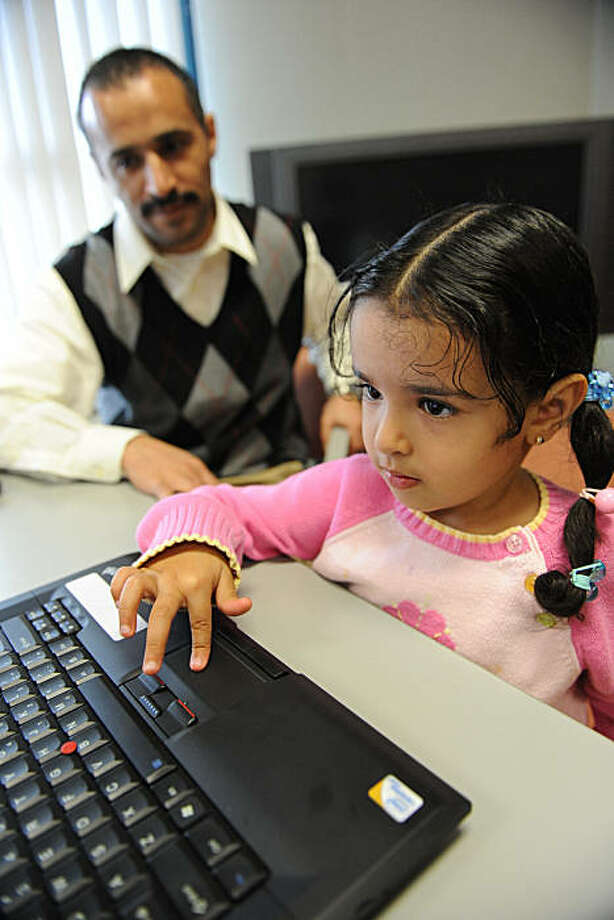 Hassan Zaher watches as his daughter Abrar (3 years) tries out a computer at 111 Jones in San Francisco on October 21, 2010 after an event put on by  One Economy to announce free internet service to the building. Photo: Susana Bates, Special To The Chronicle