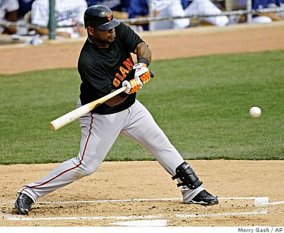 San Francisco Giants' Pablo Sandoval hits a single during the second inning of a spring training baseball game against the Los Angeles Dodgers, Wednesday, March 4, 2009, in Phoenix. Sandoval went 3-for-3 as the Giants won 10-8. (AP Photo/Morry Gash) Photo: Morry Gash, AP