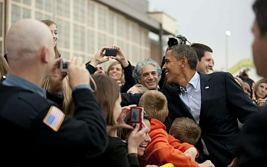 US President Barack Obama (R) shakes hands as he arrives in Minneapolis, Minnesota, October 23, 2010. President Obama is on a campaign swing in support of Democratic candidates ahead of the November 2 midterm election. Photo: Jim Watson, AFP/Getty Images