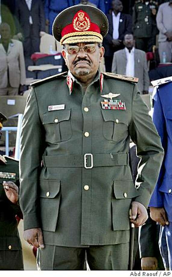 """Sudanese President Omar al-Bashir attends a graduation ceremony at an air force academy near Khartoum, Sudan, Wednesday, March 4, 2009. Sudan denounced an international tribunal that issued an arrest warrant against its president Wednesday on charges of war crimes and crimes against humanity, calling it a """"white man's court"""" that aims to destabilize the country. (AP Photo/Abd Raouf) Photo: Abd Raouf, AP"""