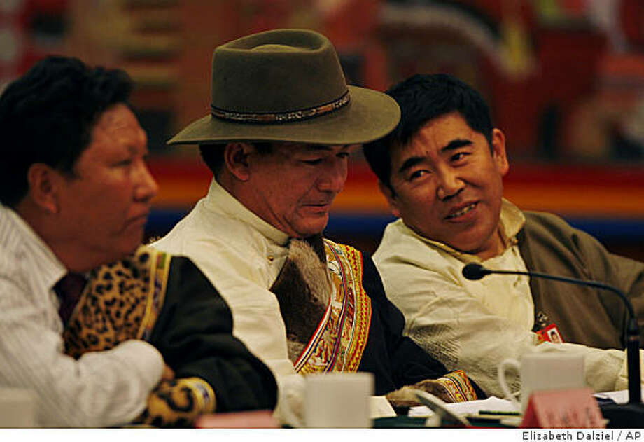 Lhasa Mayor Doje Cezhug, center, and Tibetan Delegates to the National People's Congress listen to Tibet Governor Qiangba Puncog's speech during a press conference in the Tibet Room at the Great Hall of the People in  Beijing, China, Friday, March 6, 2009. Tibet governor Qiangba Puncog said a few disgruntled individuals may cause disturbances around the upcoming one-year anniversary of the rioting in Lhasa, but that authorities did not expect any large-scale disturbances. (AP Photo/Elizabeth Dalziel) Photo: Elizabeth Dalziel, AP