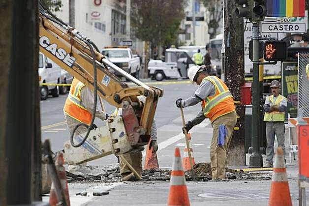 Workers at 18th and Castro Streets work at the site of a natural gas leak. The cause is under investigation on Thursday, October 21, 2010 in San Francisco, Calif. Photo: Lea Suzuki, The Chronicle