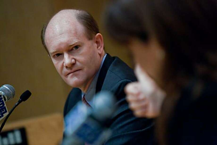 Delaware U.S. Senate candidate Chris Coons looks at his opponent, Christine O'Donnell, as she makes a thumbs-up sign during their debate   at Widener Law School in Wilmington Tuesday, October 19, 2010. Photo: Robert Craig, Associated Press